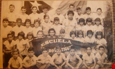 My Third Grade Class. I am the girl, in the second row, 4th in from the left, holding the corner of the banner.